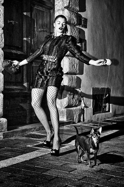 Woman walking dog, Orbetello, 2012