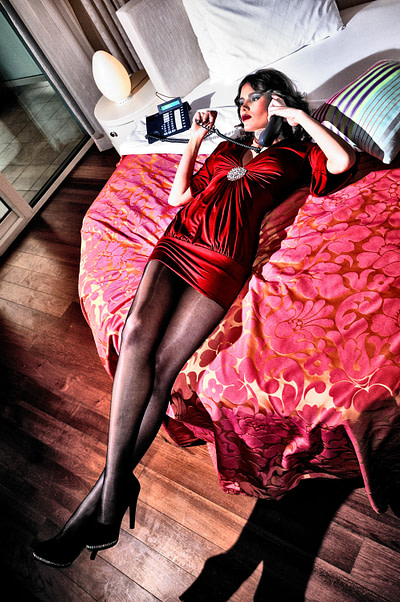 Woman lying in bed with phone, Montenegro, 2012